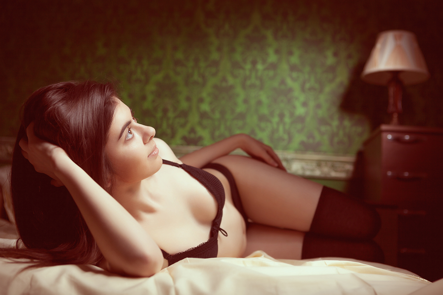 Girl In Black Lingerie In Bed