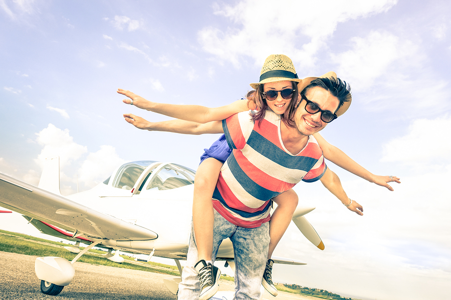Happy Hipster Couple In Love On Airplane Travel Honeymoon Vacati