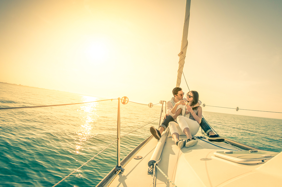 Young Couple In Love On Sail Boat With Champagne At Sunset - Hap