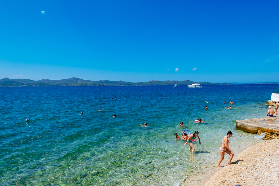 Zadar, Croatia - July 28, 2015: Tourists Swim In The Adriatic Se